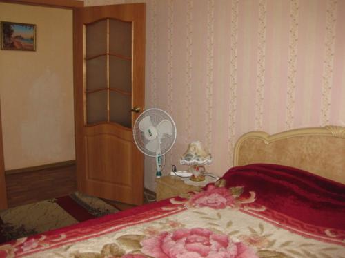 Кровать или кровати в номере Apartment Bakunina 30а