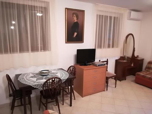 A television and/or entertainment center at Studio Apartment Palma