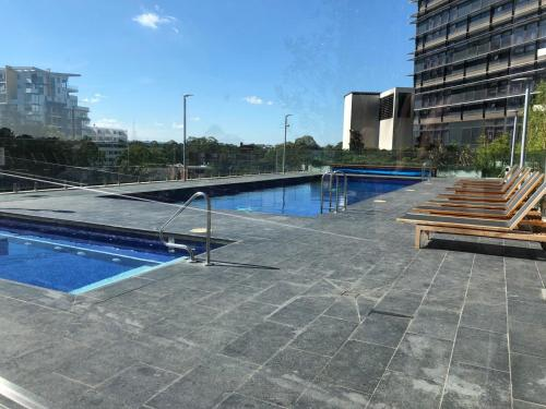 The swimming pool at or near High end riverside apartment in Parramatta CBD