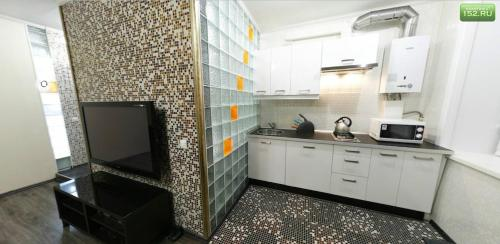 A kitchen or kitchenette at Amazing Studio