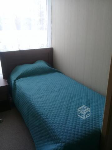 A bed or beds in a room at Habitacion en Acojedor departamento