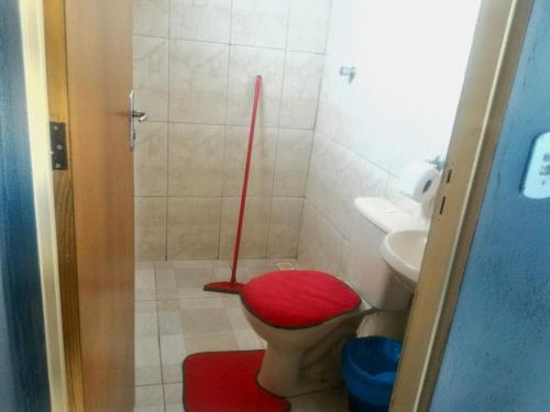 Um banheiro em Alto Paraíso Flats