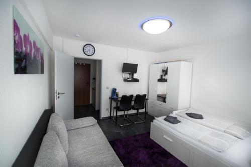 A seating area at Kleines, feines Apartment in Düsseldorf