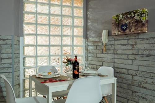 Restaurant ou autre lieu de restauration dans l'établissement Apartamento Maribel