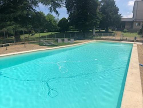 The swimming pool at or near Gites du chateau du Breuil