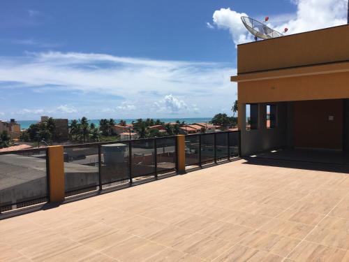 A balcony or terrace at Maragogi Praia Flats