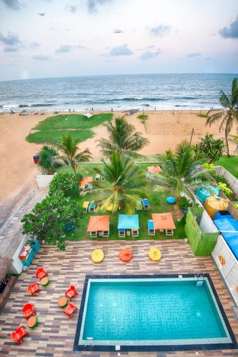 A view of the pool at Hotel J Negombo or nearby