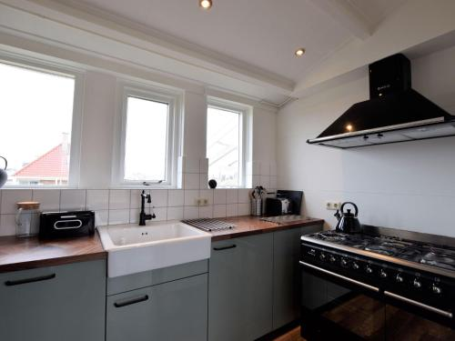 A kitchen or kitchenette at Cozy Bungalow in Midsland near Sea