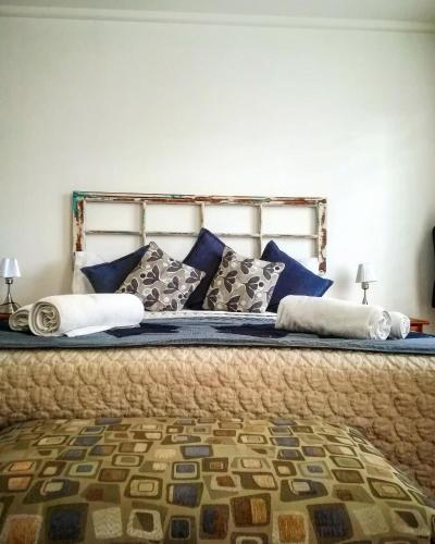 Cama o camas de una habitación en La Sastreria Hotel Boutique