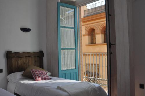 Cama o camas de una habitación en Casas y Patios de Triana