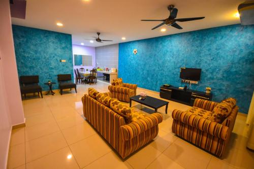 A seating area at 275 Sitiawan Homestay