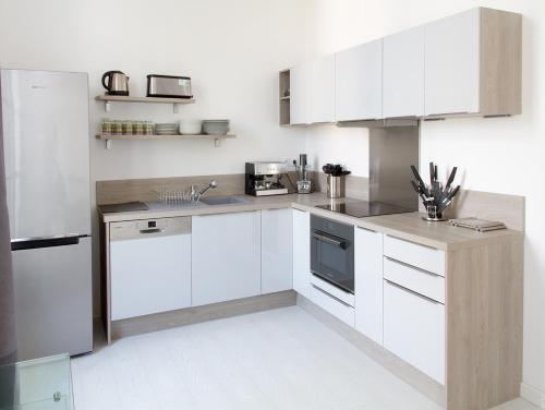 Cuisine ou kitchenette dans l'établissement Aux Iles d'Or