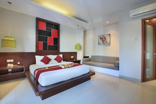 A bed or beds in a room at Samaja Beachside Villas