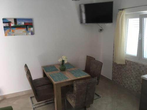 A television and/or entertainment center at Apartments Vala