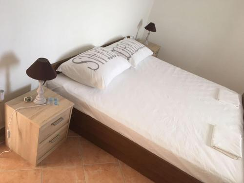 A bed or beds in a room at Apartments Vala