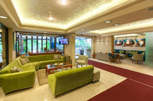 The lobby or reception area at Paradise Lost Hotel-Apartments