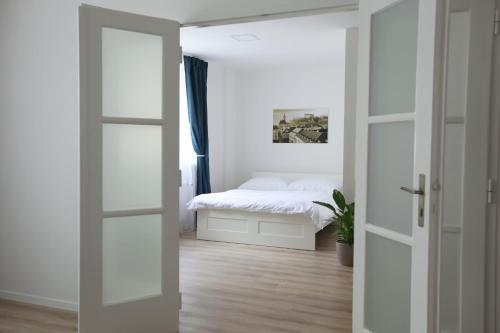 A bed or beds in a room at City Center Best Place Apartments