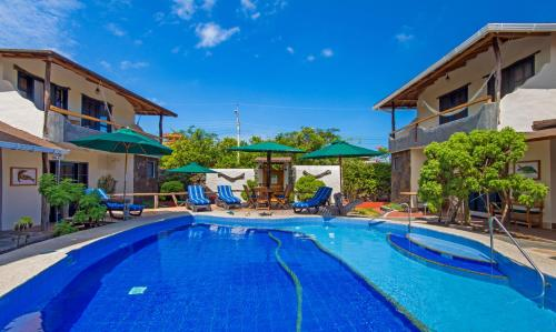Piscine de l'établissement Galapagos Cottages ou située à proximité