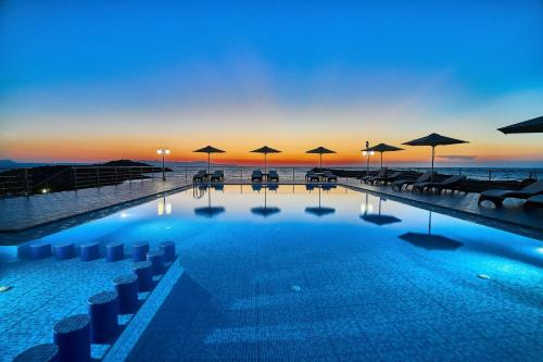 The swimming pool at or near Nanakis Beach Luxury Apartments