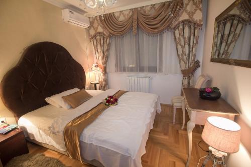 Ein Bett oder Betten in einem Zimmer der Unterkunft Apartment Barby - Deluxe