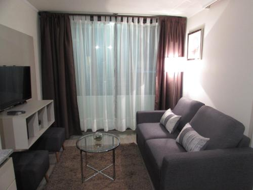 Zona de estar de Santiago Central Suites / San Martin
