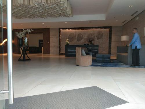 El vestíbulo o zona de recepción de Mactan Newtown Ocean View 360degree