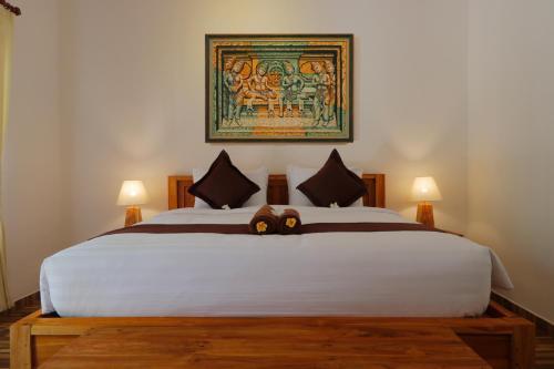 Letto o letti in una camera di Crystal Bay Villa & Residence