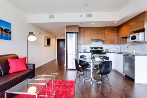 A kitchen or kitchenette at Place des festivals furnished apartments