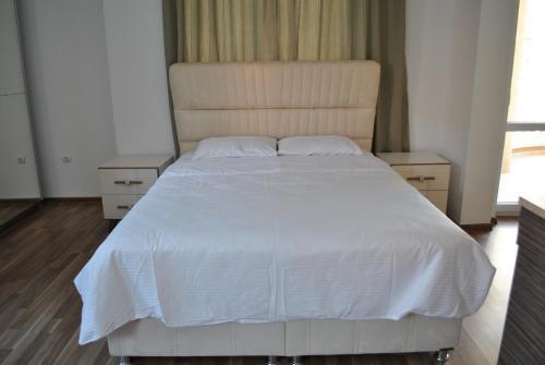 Ein Bett oder Betten in einem Zimmer der Unterkunft Villa Aria Private Apartments