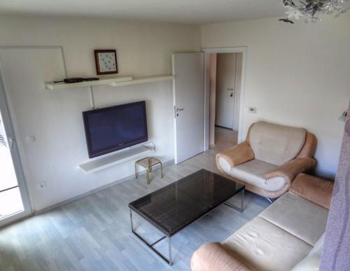 A seating area at Apartma Pina