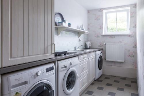 Kuchnia lub aneks kuchenny w obiekcie Apartament na Mazurach