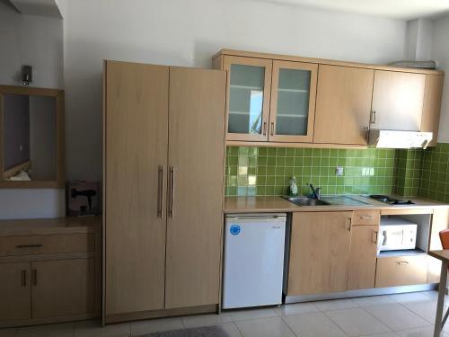 Η κουζίνα ή μικρή κουζίνα στο Kleanthi Studios