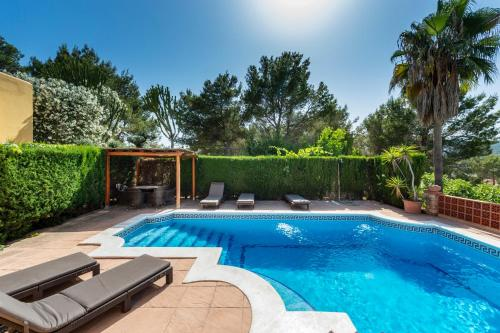The swimming pool at or near Villa Can Palazon
