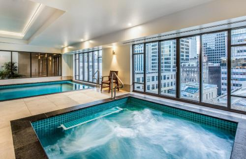 The swimming pool at or near Avani Metropolis Auckland Residences