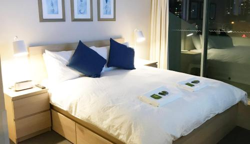 A bed or beds in a room at Seasun Legends Hotel