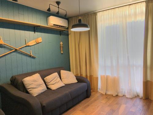 Гостиная зона в Apartment on Ulitsa Divnaya 2