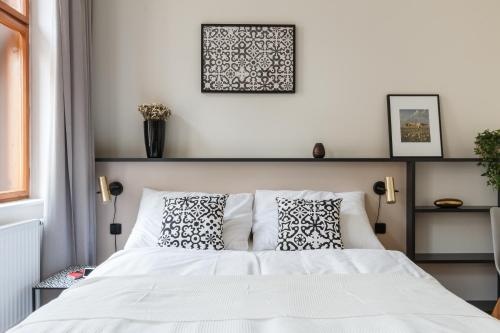 Ein Bett oder Betten in einem Zimmer der Unterkunft Prime Aparts Prague