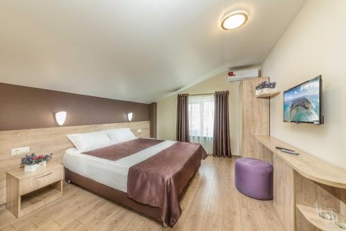 A bed or beds in a room at Villa La Melia
