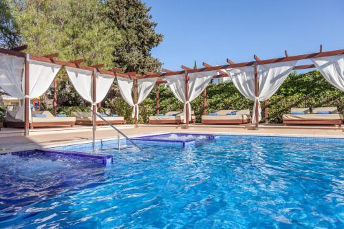 The swimming pool at or near Zafiro Palmanova