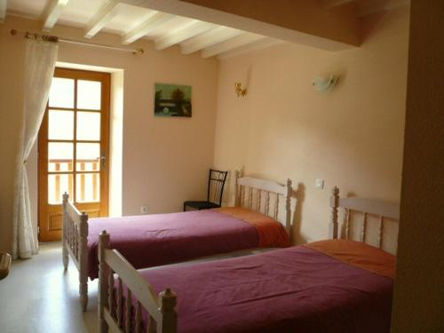 Un ou plusieurs lits dans un hébergement de l'établissement La Gentilhommière