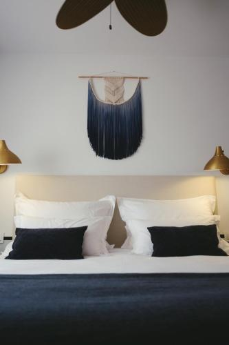A bed or beds in a room at Mikasa Boutique Hotel Ibiza * ADULTS ONLY