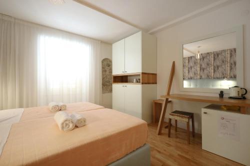 Postelja oz. postelje v sobi nastanitve Central Apartments Integrated Hotel