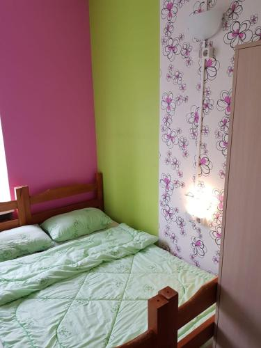 A bed or beds in a room at Hostel Time at the Red Gate