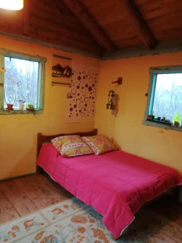 Una cama o camas en una habitación de Casa en El Bolson