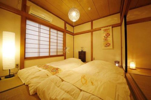 A bed or beds in a room at Apartment in Osaka 2878
