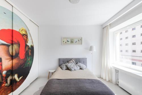Кровать или кровати в номере Apartament w sercu miasta
