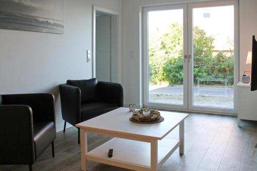 Ein Sitzbereich in der Unterkunft Haus an den Salzwiesen - Wohnung Lachmöwe