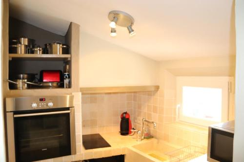 A kitchen or kitchenette at Charme En Provence