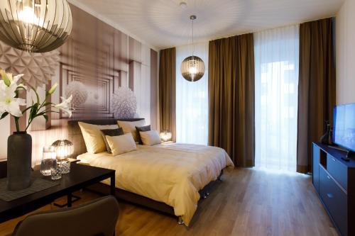 Ein Bett oder Betten in einem Zimmer der Unterkunft vienna westside apartments