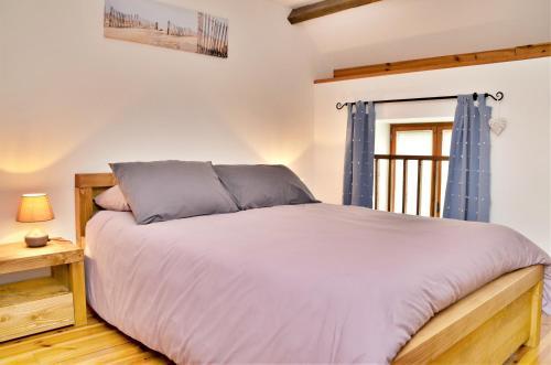 Un ou plusieurs lits dans un hébergement de l'établissement Domaine de Lestroué
